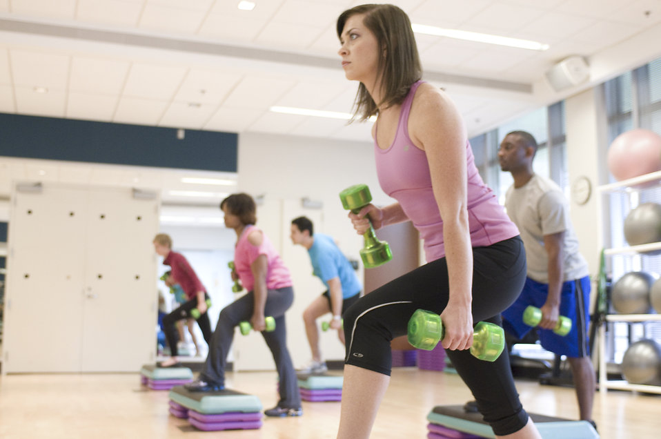 17368-men-and-women-performing-aerobic-exercises-pv